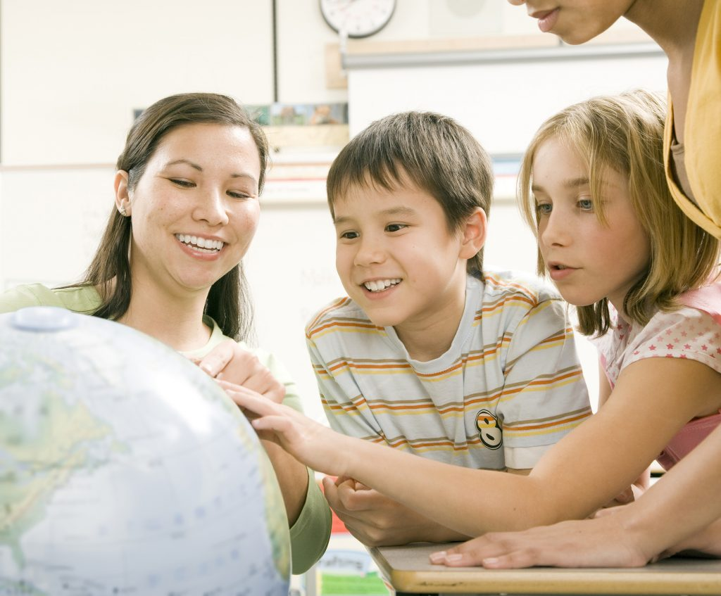 Teacher Shows Young Students A Globe